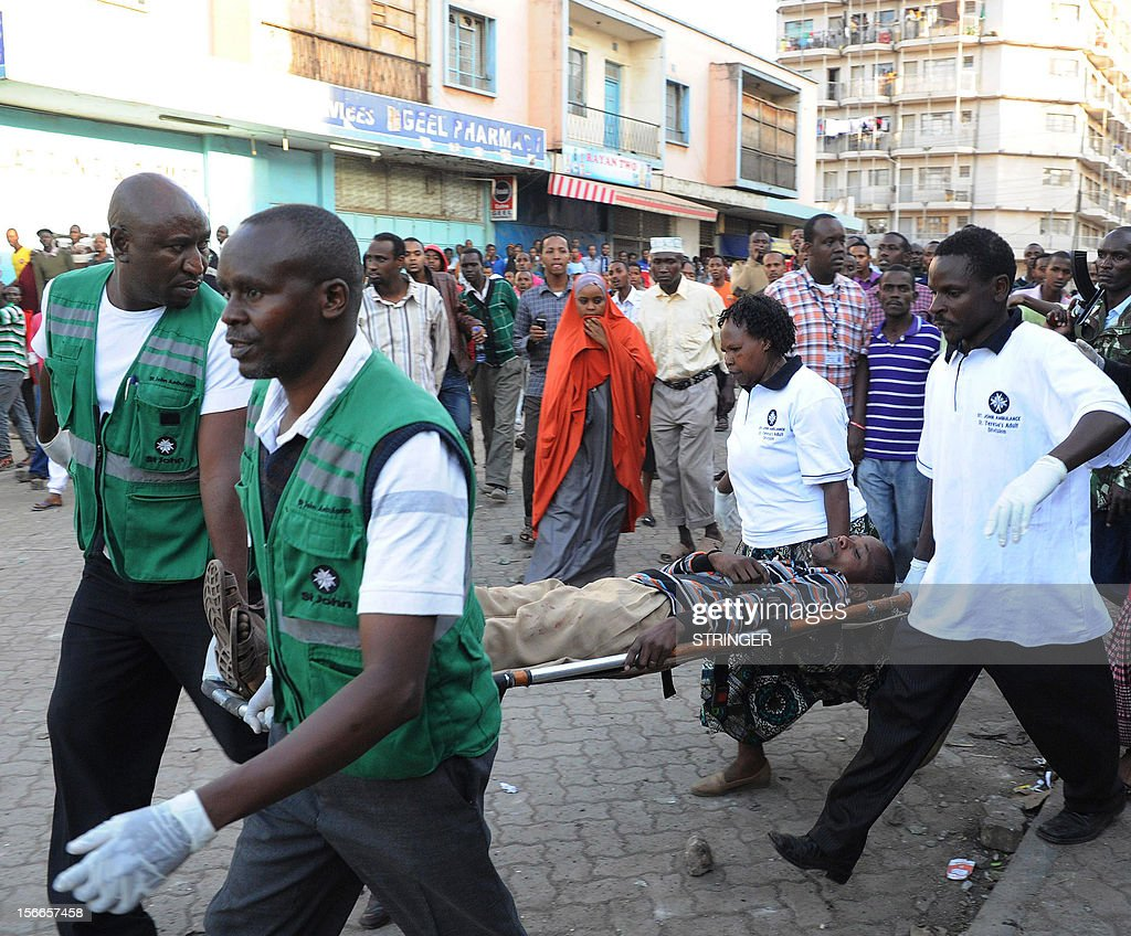 A casualty of a suspected bomb attack is carried away by medics from the scene of the attack, in Nairobi's Eastleigh suburb, on November 18, 2012. Seven people were killed and many more wounded when an apparent explosive device was hurled at a packed minibus in a predominantly Somali area of the Kenyan capital Nairobi today, police and the Red Cross said. Nairobi police chief Moses Nyakwama said the blast occurred on a so-called 'matatu', or local minibus, in the district of Eastleigh, where mainly Somalis or Kenyans of Somali origin live and which has been the target of other attacks in recent weeks.