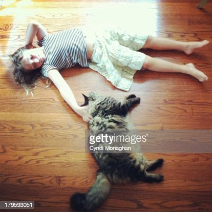 Cat and girl : Stock Photo