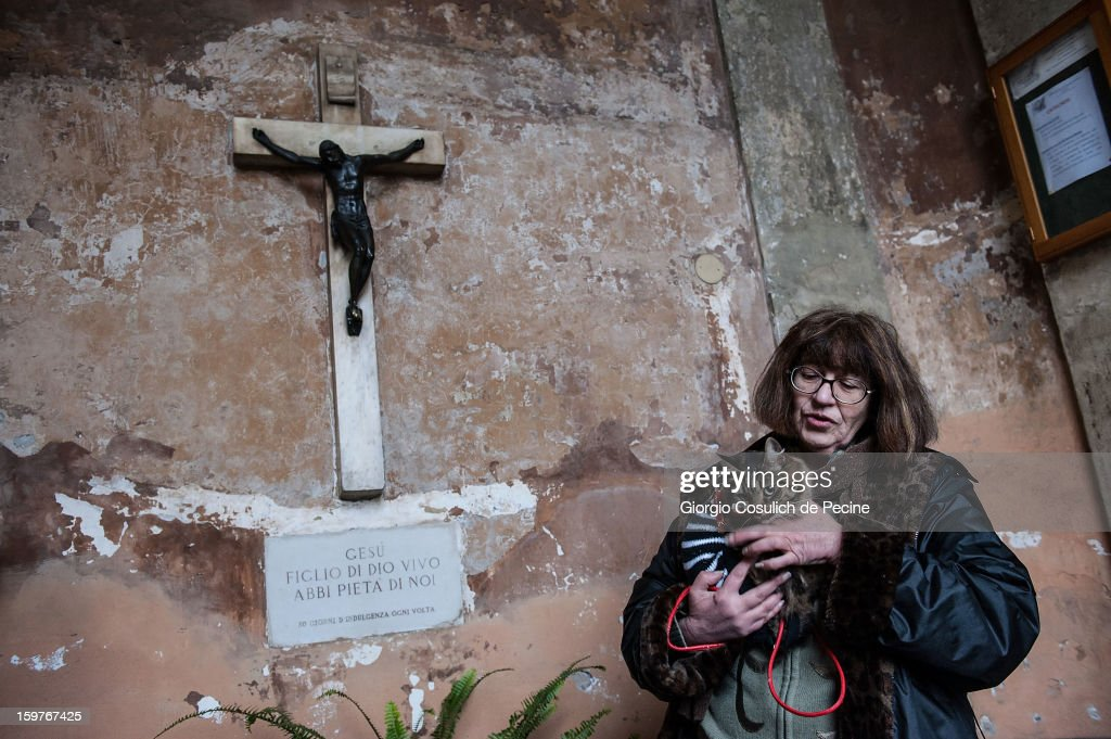 A cat and its owner wait for the start of a traditional mass for the blessing of animals at the Sant'Eusebio church on January 20, 2013 in Rome, Italy. Every year during the feast of St. Anthony the Abbot animals are blessed in countries around the world.