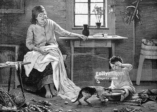 Cat drinking milk from a boy's milkbowl the mother is watching historic wood engraving about 1888