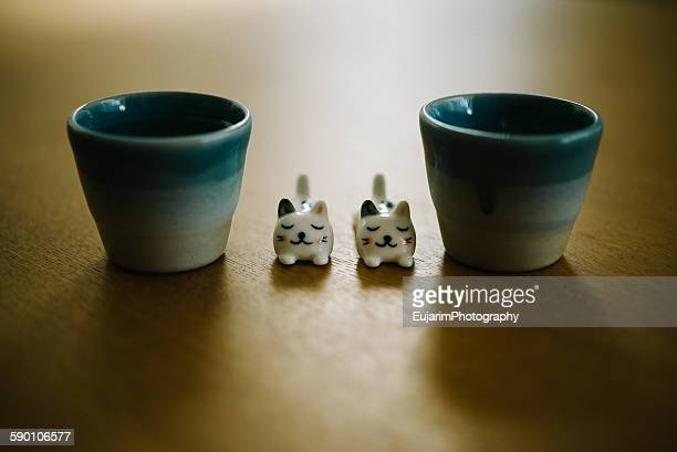 Cat figurines and japanese sake cups