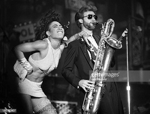 Cat Glover and Eric Leeds perform on stage with Prince on the Sign of the Times Tour at Isstadion Stockholm Sweden 9th May 1987