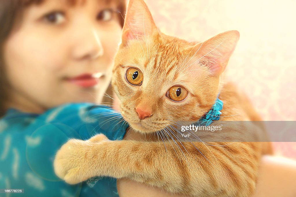 Cat on a woman's arm.