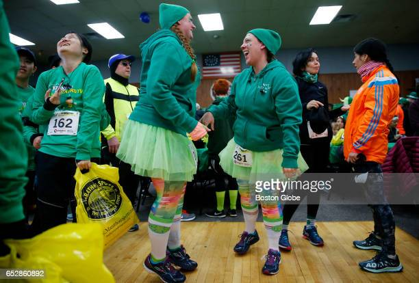 Cat Sabel left and Leslie Leedberg both of Southborough laugh as they dance to Irish music before the start of the 4th Annual 'Running of the...