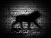 3D render of a cat walking with lion shaped shadow against a brick wall