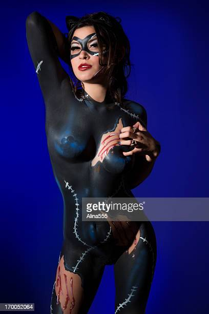 Cat woman: young girl with a feline bodypaint