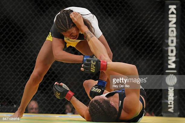 Cat Zingano kicks Julianna Pena during the UFC 200 event at TMobile Arena on July 9 2016 in Las Vegas Nevada