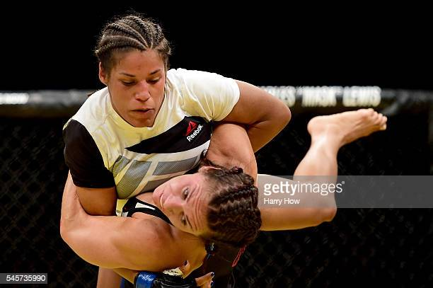 Cat Zingano wrestles with Julianna Pena in their women's bantamweight bout during the UFC 200 event on July 9 2016 at TMobile Arena in Las Vegas...
