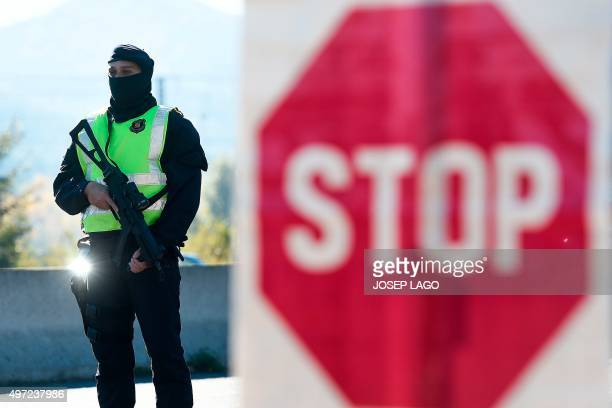 A Catalan Autonomous Police officer known as Mosso d'Esquadra stands guard at a toll station during vehicles controls on a motorway of Barcelona...