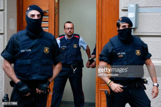 Catalan autonomous police officers known as Mosso d'Esquadra detain a cuffed suspect in Ripoll during a search linked to the deadly terror attacks in...