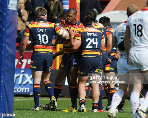 Catalan Dragons' Leon Pryce is congratulated after scoring his side's first try during the Carnegie Challenge Cup match at the MS3 Craven Park...