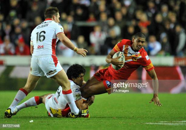 Catalan Dragons Leon Pryce is tackled by St Helens' Sia Soliola during the Stobart Super League match at Langtree Park St Helens