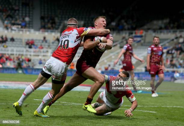 Catalan Dragons' Remi Casty makes a high tackle on Huddersfield Giants' Alex Mellor during day two of the Betfred Super League Magic Weekend at St...