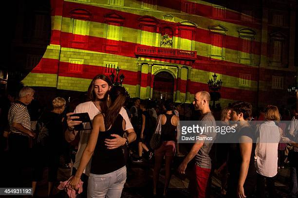 Catalan flag is projected on the facade of the Palau de la Generalitat the Catalan Government building in memory of the Catalans who fought for their...