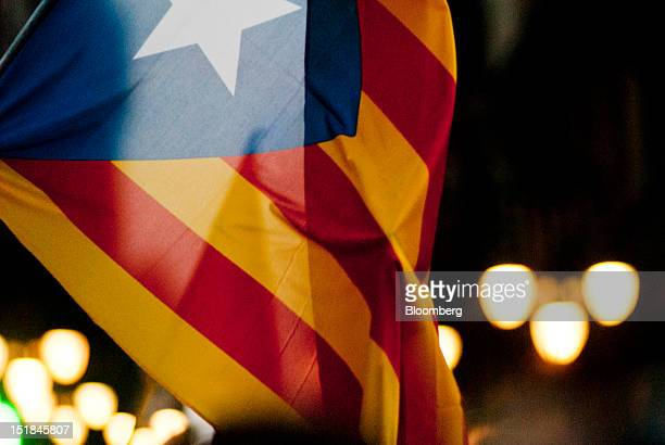A Catalan flag is seen during a march in favour of regional independence and to protest against the Spanish government's tax laws during the National...