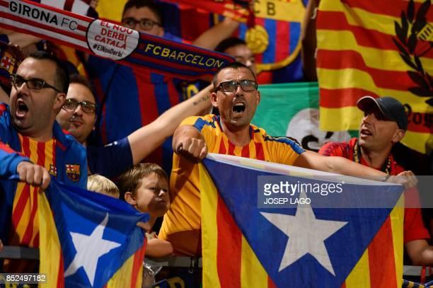 Catalan football fans hold Esteladas before the Spanish league football match Girona FC vs FC Barcelona at the Montilivi stadium in Girona on...