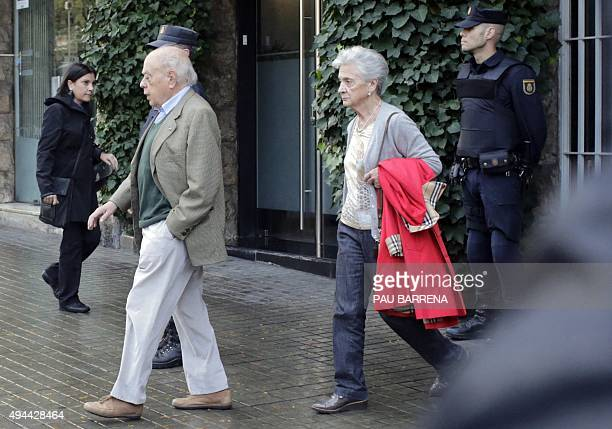 Catalan former President Jordi Pujol and his wife Marta Ferrusola leave their home in Barcelona during a police search on October 27 2015 Spanish...