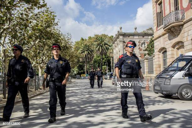 Catalan Mossos d'Esquadra police prepare for the arrival of Carles Puigdemont Catalonia's president at the entrance to the Catalonian parliament in...