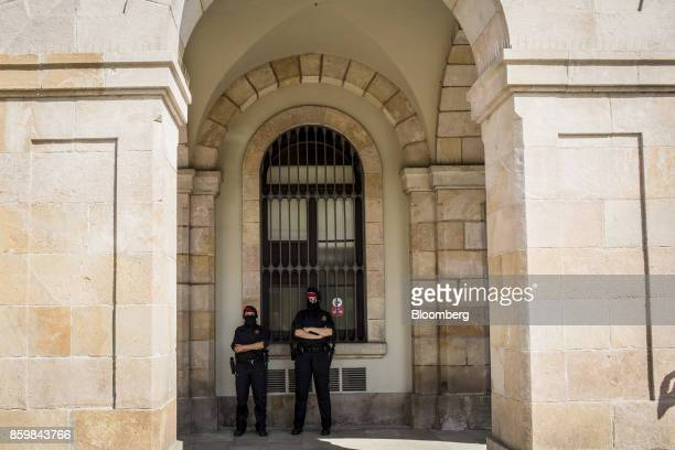 Catalan Mossos d'Esquadra police stand guard for the arrival of Carles Puigdemont Catalonia's president at the entrance to the Catalonian parliament...