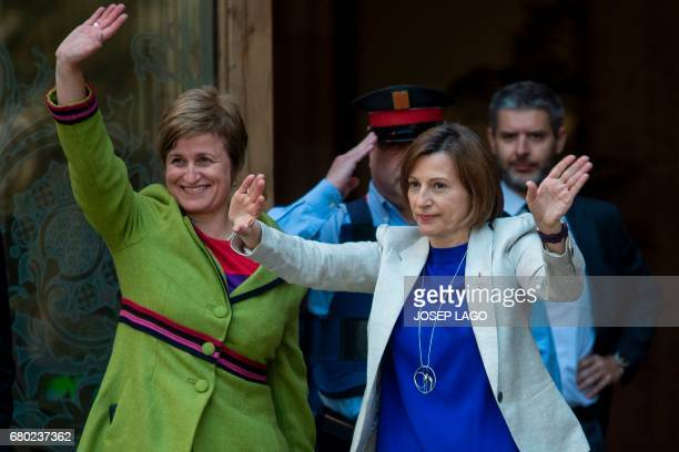 Catalan parliament President Carme Forcadell and member of the Catalan parliament board Anna Simo wave upon their arrival at the TSJC in Barcelona on...