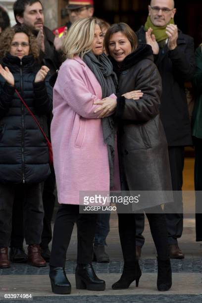Catalan parliament President Carme Forcadell hugs former Catalan vicepresident of Catalan Government Joana Ortega as the latter leaves the...