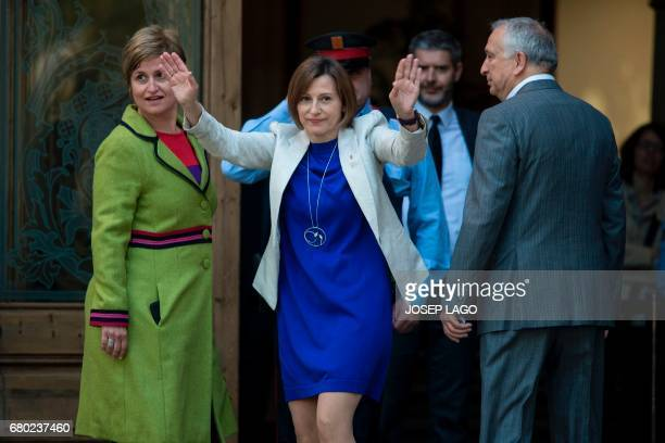 Catalan parliament President Carme Forcadell waves past member of the Catalan parliament board Anna Simo upon their arrival at the TSJC in Barcelona...