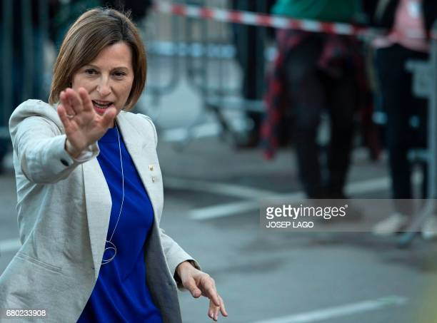Catalan parliament President Carme Forcadell waves upon her arrival at the TSJC in Barcelona on May 8 2017 Forcadell is charged with civil...