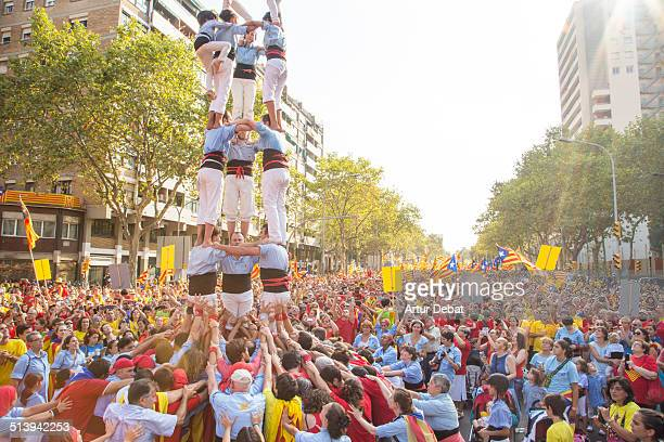 Catalan people celebrates the Catalonia national day on 9/11 with a rally in the streets of Barcelona with the streets of Gran Via and the Diagonal...