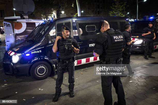 Catalan Police Mossos d'Esquadra officers stand by as the rally disband This provincial law enforcement is presumably targeted by Spanish government...