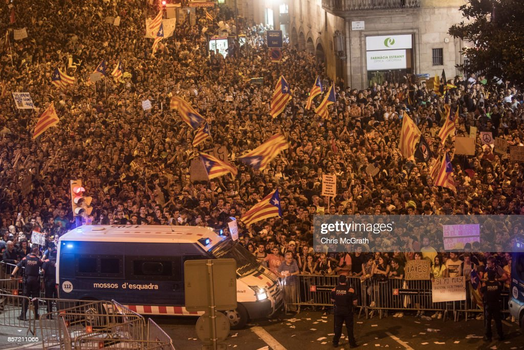 Catalan Police officers secure the area as thousands of people chant slogans outside the General Direction of the National Police of Spain building to protest against the violence that marred Sunday's referendum vote during a regional general strike on October 3, 2017 in Barcelona, Spain. According to the Catalonia's government more than two million people voted on Sunday in the referendum of Catalonia, which the Government in Madrid had declared illegal and undemocratic. Officials said that 90% of votes cast were for independence. The Catalan goverment's spokesman said that an estimated of 770,000 votes were lost as a result of 400 polling stations being raided by Spanish police. Hundreds of citizens were injured during the police crackdown.