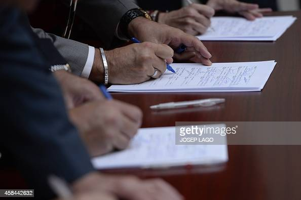 Catalan politicians sign a petition during a meeting of Catalan political parties on November 5 2014 in Barcelona where they announced their intent...
