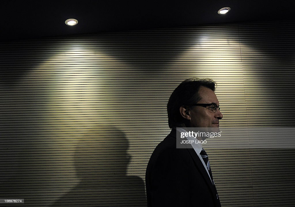 Catalan president and leader of the Catalan Convergence and Unity party (CiU) Artur Mas leaves at the end of a press conference in Barcelona on November 26, 2012. Catalonia's fight for statehood and a historic divorce from Spain floundered today after a snap election left no single party in command. Mas' centre-right nationalist alliance, Convergence and Union, remained well ahead in the vote but its share of the 135 parliamentary seats plunged from 62 to just 50. AFP PHOTO / JOSEP LAGO