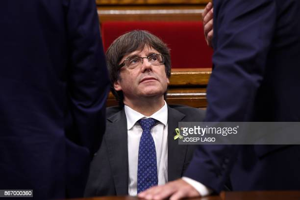 Catalan president Carles Puigdemont attends a session of the Catalan parliament in Barcelona on October 27 2017 The Catalan parliament will vote on...