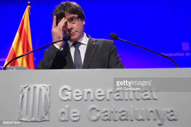 Catalan president Carles Puigdemont gestures during a press conference in Barcelona on October 2 2017 Catalonia's leader Carles Puigdemont said the...