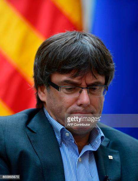 Catalan president Carles Puigdemont gestures during an AFP interview in Girona on September 30 2017 The mission was entrusted to him almost by...