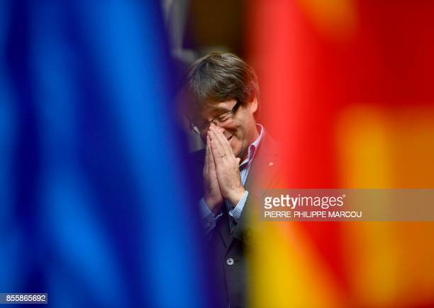 TOPSHOT Catalan president Carles Puigdemont gestures during an AFP interview in Girona on September 30 2017 The mission was entrusted to him almost...
