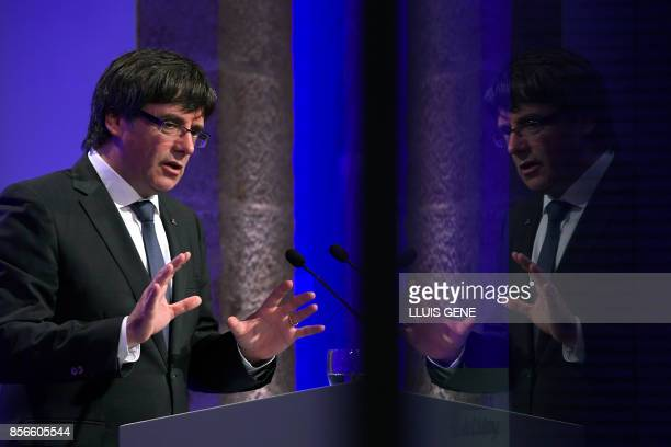 TOPSHOT Catalan president Carles Puigdemont is reflected on a window during a press conference in Barcelona on October 2 2017 Catalonia's leader...
