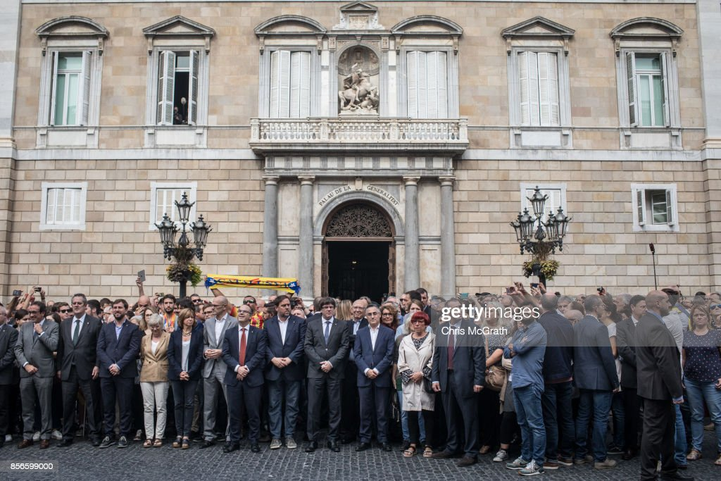 Catalan President Carles Puigdemont (9th-L) joins with government, city hall and union officials to pose for photographs in protest of the violence that marred yesterday's referendum vote outside the Palau Generalitat building on October 2, 2017 in Barcelona, Spain. Catalonia's government met Monday to discuss plans to declare independence after the results of yesterday's disputed referendum.