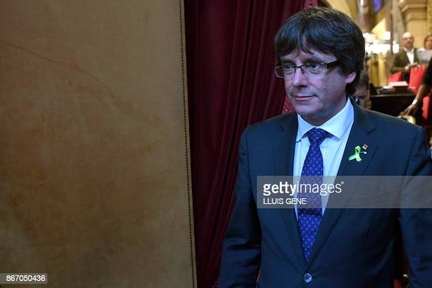 Catalan president Carles Puigdemont leaves the hemicycle after Catalonia's parliament voted to declare independence from Spain on October 27 2017 in...
