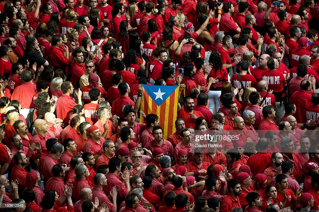 A Catalan Pro-Independence flag is held up by members of a colla as the sing the Catalan National Anthem during the 24th Tarragona Castells Comptetion on October 7, 2012 in Tarragona, Spain. The 'Castellers' who build the human towers with precise techniques compete in groups, known as 'colles', at local festivals with aim to build the highest and most complex human tower. The Catalan tradition is believed to have originated from human towers built at the end of the 18th century by dance groups and is part of the Catalan culture.