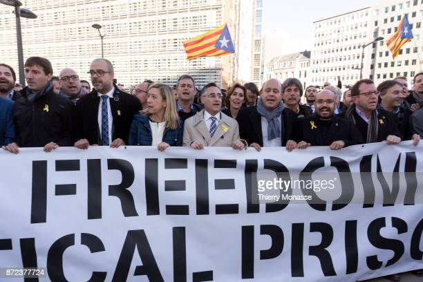 Catalan proindependence mayors hold a banner as they demonstrate in support of detained officials in front of the European Commission building in...