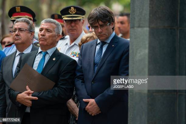 Catalan regional government Carles Puigdemont President of Catalan Association of Terrorism Victims Jose Vargas and Spanish Interior Minister Juan...