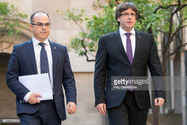 Catalan regional government president Carles Puigdemont and Catalan government spokesperson Jordi Turull arrive for a regional government meeting at...
