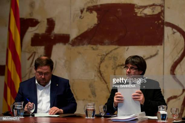 Catalan regional government president Carles Puigdemont and Catalan regional vice president and chief of economy and finance Oriol Junqueras attend a...