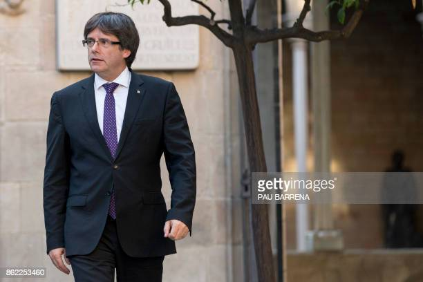 Catalan regional government president Carles Puigdemont arrives for a regional government meeting at the Generalitat Palace in Barcelona on October...