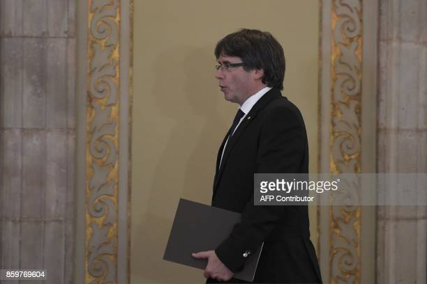 Catalan regional government president Carles Puigdemont arrives to address the Catalan regional parliament in Barcelona on October 10 2017 Spain's...