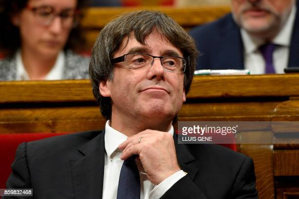 Catalan regional government president Carles Puigdemont attends a session of the Catalan regional parliament in Barcelona on October 10 2017...