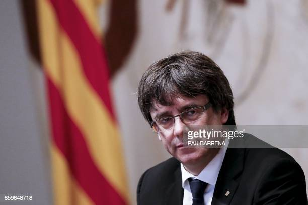 TOPSHOT Catalan regional government president Carles Puigdemont attends a regional government meeting at the Generalitat Palace in Barcelona on...