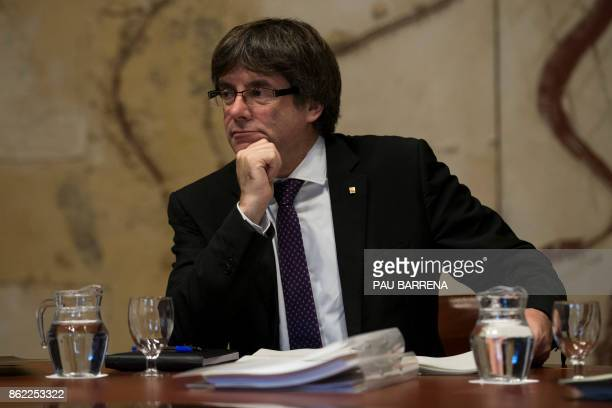 Catalan regional government president Carles Puigdemont attends a regional government meeting at the Generalitat Palace in Barcelona on October 17...