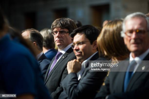 Catalan regional government president Carles Puigdemont attends a protest against the arrest of two Catalan separatist leaders in Barcelona on...